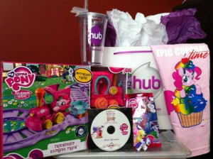 """My Little Pony Friendship Express Train Set with a My Little Pony figure, DVD, HUB Network tumbler, """"Epic Cupcake Time"""" t-shirt, and much more!! The girls are in Pony Heaven now :-)"""