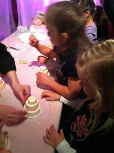 Decorating mini-wedding cakes provided by The Butter End Cakery.